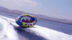 Youngsters Tubing And Wakeboarding In Slow Motion Stock Footage