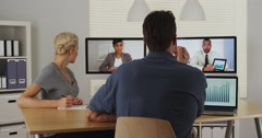 Diverse business colleagues working together via the internet - stock footage