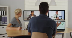 Multi-ethnic businessteam having a positive meeting - stock footage