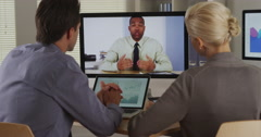 Stock Video Footage of Businessteam listening to manager in a video conference