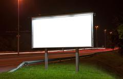 Billboard on highway by night - stock photo