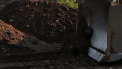 Construction bulldozer moving soil detail Stock Footage