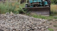 excavator grader removing the ground - stock footage