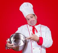 chief cook showing empty pot - stock photo