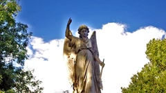Angel statue in a cemetery  with clouds - stock footage