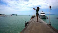 Woman take a picture from bridge of nature on the island Koh Samui. Bophut beach Stock Footage
