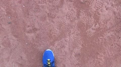 Runner running on the red clay in stadium Stock Footage