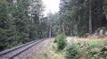 Classic steam locomotive pulling wagons closeup in forest panning HD Footage