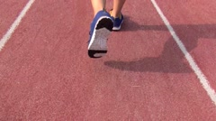 Runner running on the track in stadium Stock Footage