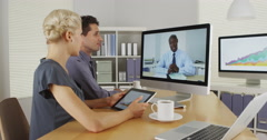 African businessman remotely having a discussion with colleagues Stock Footage