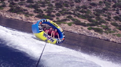 Friends In Action Tubing On Summer Vacations Stock Footage