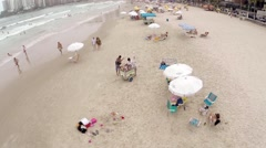 People enjoying a summer day at Beach in São Paulo, Brazil - stock footage