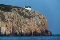 Stock Photo of home on high cliff
