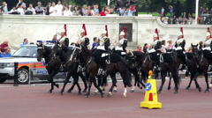 Horse mounted guards ride by Victoria monument Buckingham Palace Stock Footage