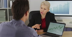 Business partners discussing future marketing ideas - stock footage