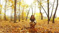 Brunette girl in autumn park - stock footage