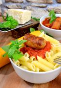 rigatoni italian pasta with tomato sauce - stock photo