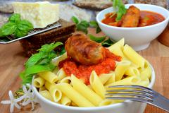 rigatoni italian pasta with tomato sauce - stock photo