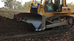 Construction bulldozer moving soil and rocks Stock Footage