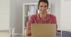 Attractive company representative sititng at desk Stock Footage