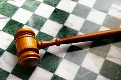 judges wooden gavel on a chess board - stock photo