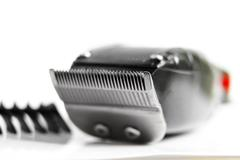 Closeup of hair clippers and guide, on white Stock Photos