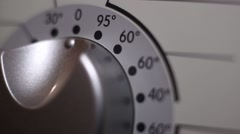 Programming a washing machine by choosing the temperature Stock Footage