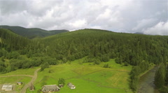 Beautiful mountain district with  river and  wood. Aerial  panorama Stock Footage