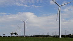 WINDTURBINES AND POWER LINES 4.  Color Corrected to Proper Blue. Stock Footage