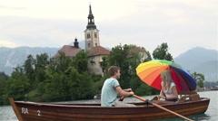 Stock Video Footage of Medium shot of couple on rowboat enjoying romance