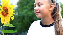 Child with sunflower Stock Footage