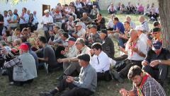 Pilgrims praying at the grave of Sari Saltik Baba Stock Footage