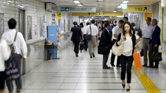Zoom Out - Time Lapse of Commuters at Busy Tokyo Metrorail System Stock Footage
