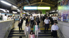 Time Lapse of Commuters at Busy Tokyo Metrorail System Stock Footage