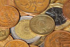 Different coins taken closeup. Stock Photos