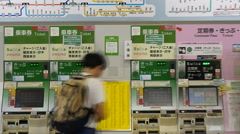 Zoom Out - Time Lapse of Commuters using Ticket Machine - Tokyo Metrorail System Stock Footage