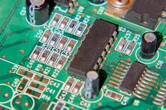 Green electronic microcircuit with microchips. Stock Photos