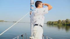 Yachtsman standing on bow of sailing yacht. Sport, recreation Stock Footage