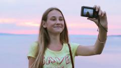 Stock Video Footage of Teenage Girl Taking Self Portrait With Camera At Sunset HD