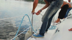 Crew working on deck, tying knots, training. Summer activities Stock Footage