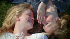 Closeup Of Two Girls Sharing Secrets With Each Other (Shot From Above) Stock Footage