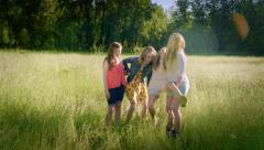 3 Girls Lift Up Their Sister In A Field, Candid Moment Of Girls Goofing Around Stock Footage