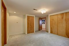empty basement room with closet - stock photo