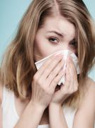 Flu allergy. sick girl sneezing in tissue. health Stock Photos