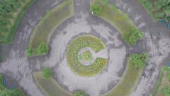 Aerial vertical shot of flower-bed in park, extreme circling Stock Footage