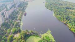 Aerial vertical shot of city park and beautiful wide river Arkistovideo