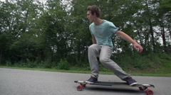 Longboard skating low angle wide slow motion - stock footage