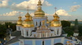 Church with golden domes and crosses, city panorama aerial Footage