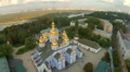 Majestic aerial view of church with golden domes, cityscape HD Footage