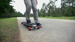 Longboarder stop and pick up skate close up slow motion Stock Footage